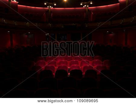 Follow spot on red velvet seat in a generic theater or movie cinema theater