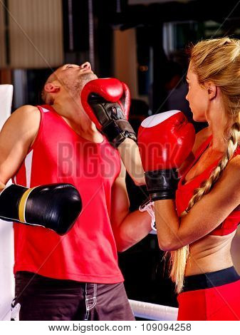 Couple Man and  Woman Wearing Gloves Boxing in Ring showdown.
