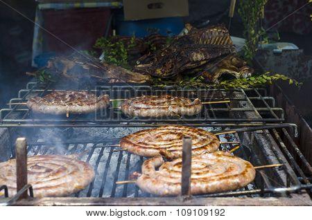 Typical Sardinian Food. Sausages Roast, Pieces Of Meat Roast And  Steaks Roast In A Typical Sardinia