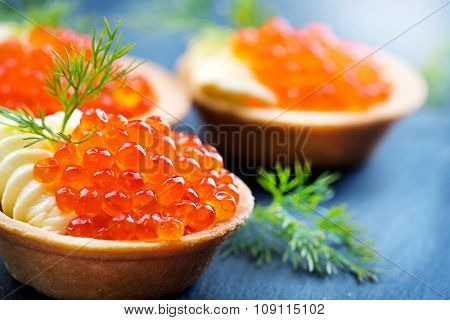 Tartlet with red caviar close up. Snacks with red caviar, gourmet food, appetizer