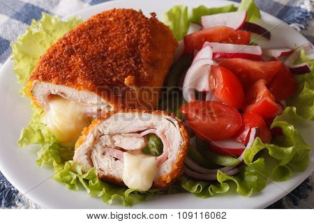 Chicken Cordon Bleu And Vegetable Salad Closeup. Horizontal