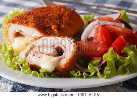 Chicken Cordon Bleu Cut And A Salad Close-up. Horizontal