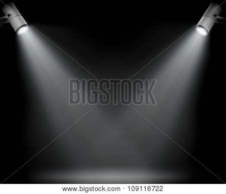 Two spotlights on black background