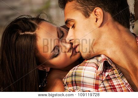 Beautiful man and woman embracing in nature. portrait