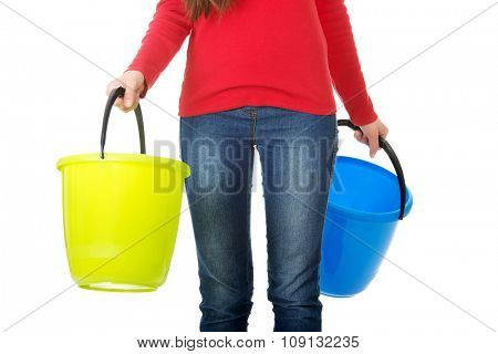 Woman holding empty colorful plastic buckets.
