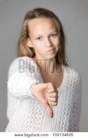 Girl Showing Thumbs Down