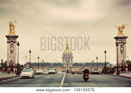 Les Invalides dome seen from Pont Alexandre III bridge in Paris, France. Vintage poster