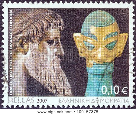 GREECE - CIRCA 2007: Stamp shows Zeus of Artemision statue and bronze sculpture with golden mask