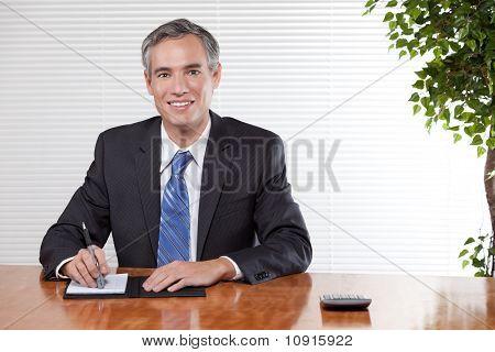 Business Man Behind A Desk