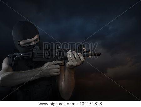 Balaclava and terrorist with machine gun on Cloud Background poster