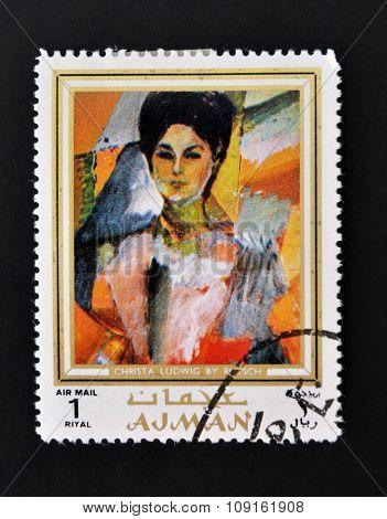 AJMAN - CIRCA 1970 A stamp printed in Ajman shows Christa Ludwig portrait by Alexander Rutsch