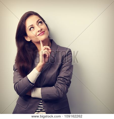 Beautiful Young Business Woman Thinking And Looking Up