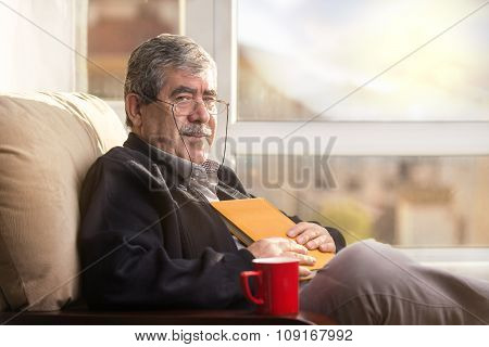 Senior Man with book