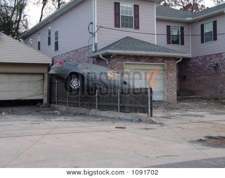 Car Washed On To A Fence.