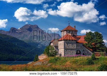 Amazing sunny day at Champferersee lake in the Swiss Alps. Castle of Crap da Sass, Silvaplana village, Switzerland, Europe.