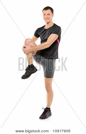 Full Length Portrait Of A Young Athlete Exercising