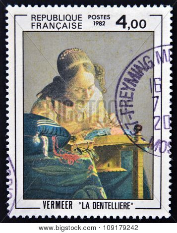 FRANCE - CIRCA 1982: a stamp printed in France shows The Lacemaker Painting by Vermeer circa 1982