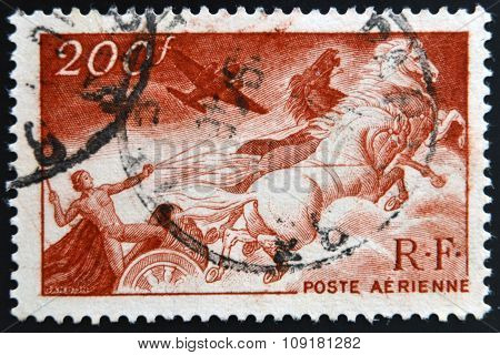 FRANCE - CIRCA 1946: A stamp printed in France shows Apollo on the chariot of the sun circa 1946