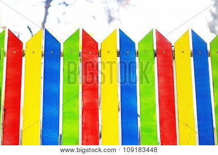 Natural wooden rainbow colored boards. Painted wooden multicolored vertical planks.