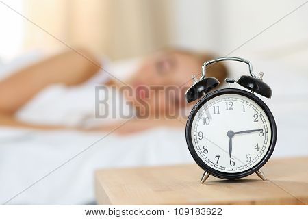 Alarm Clock Standing On Bedside Table Going To Ring Early Morning
