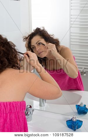 Woman, 40, Applying Makeup Cosmetics Early Morning At Home Bathroom