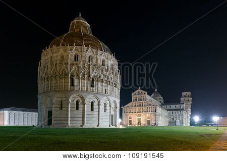 Baptistry, Cathedral And Leaning Tower Of Pisa At Night