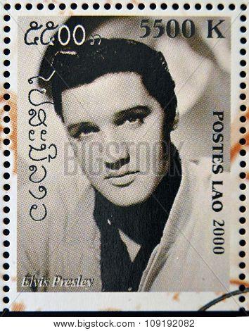 LAOS - CIRCA 2000: A stamp printed in Laos showing Elvis Presley circa 2000