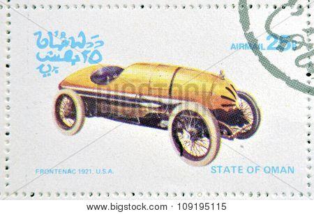OMAN - CIRCA 1977: A stamp printed in State of Oman shows a old car Frontenac 1921 usa circa 1977