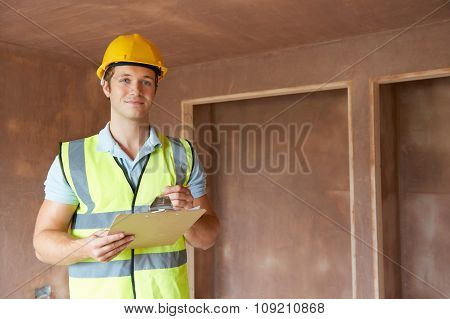 Building Inspector Looking At New Property