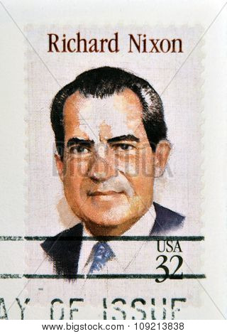 a stamp printed in USA showing an image of president Richard Nixon circa 1995.