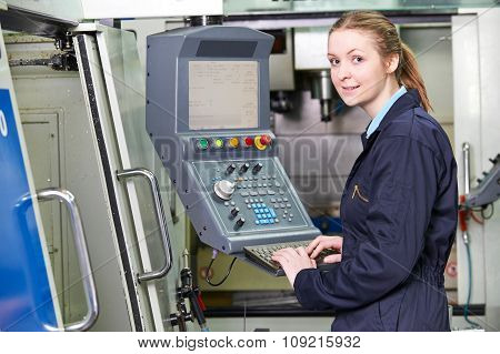 Female Apprentice Engineer Operating Computerized Cutting Machin