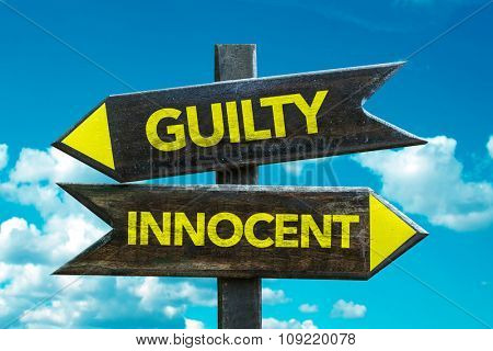 Guilty - Innocent signpost with sky background