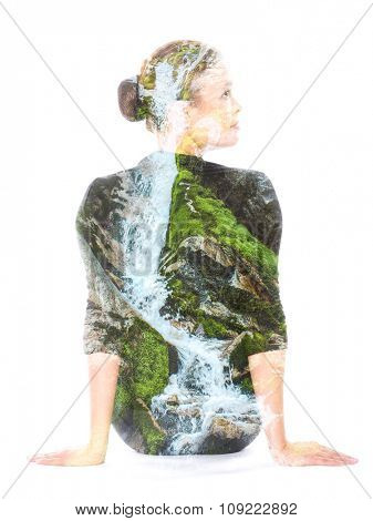 Double exposure portrait of a woman, combined with photograph of waterfall