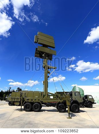 MOSCOW REGION  -   JUNE 17: Military mobile radar station consisting of the all-around antenna and command post on a rotating platform   -  on June 17, 2015 in Moscow region