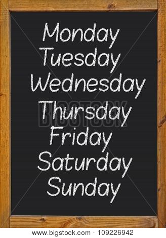 the weekdays written on a blackboard