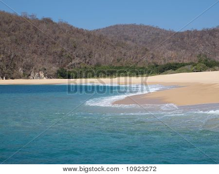 Seven Bay in Huatulco, Mexico. This bay has no access on land, only by the ocean, so it is extremely clean and untouched. poster