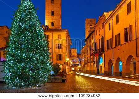 Illuminated Christmas tree on town square in Alba, Piedmont, Northern Italy.
