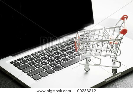 Mini Shopping Cart On Laptop With Filtered Process : Online Shopping Concept