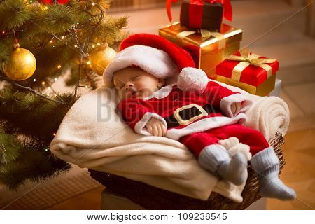 Baby Santa Sleeping Under Christmas Tree With Presents
