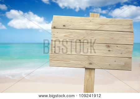 Vintage Rustic Wooden Sign On The Beach