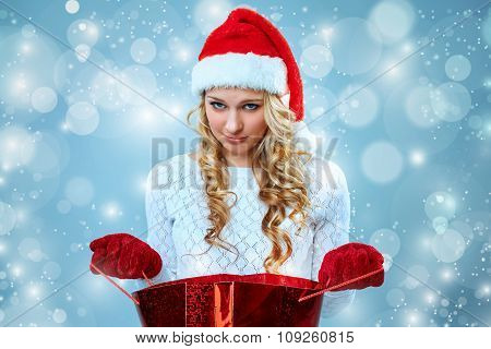 Frustrated and annoyed beautiful young woman in Santa Claus hat