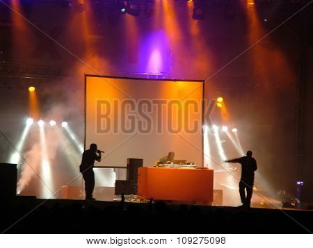 Two MCs performing with one DJ at the stage