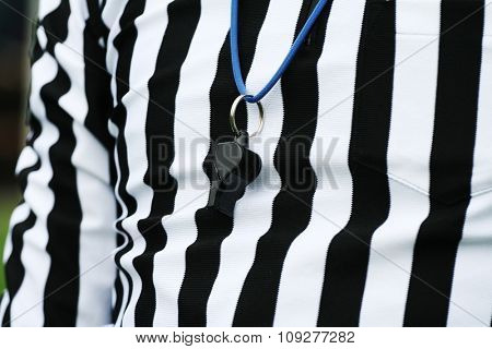 Sport competition referee. Judge concept. Referee suit and a whistle