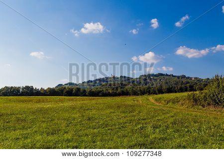 Field, hill, church.