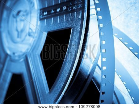 Blue Film reels closeup. Movie industry concept