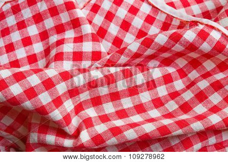 Red picnic cloth background. Texture detail closeup