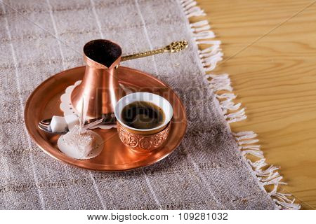 Turkish traditional coffee with cup and sugar on plate