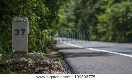 Milepost Or Kilometer Stone On The Road