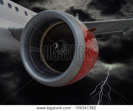 Airplane With Red Engine Flying In Stormy Clouds