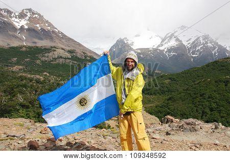 Climber waving a flag of Argentina